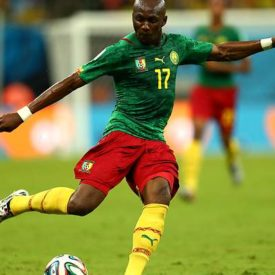 MANAUS, BRAZIL - JUNE 18: Stephane Mbia of Cameroon strikes the ball during the 2014 FIFA World Cup Brazil Group A match between Cameroon and Croatia at Arena Amazonia on June 18, 2014 in Manaus, Brazil.  (Photo by Clive Brunskill/Getty Images)